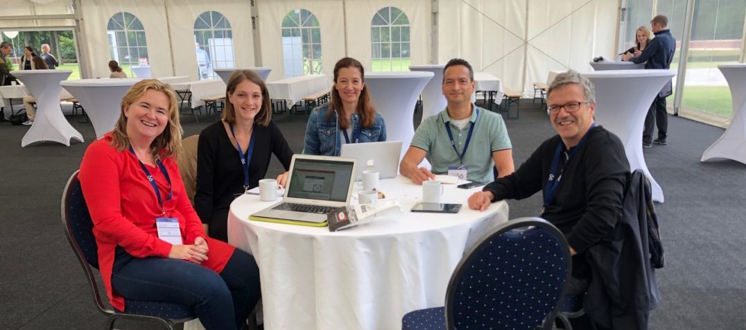 Consortium Members sitting at a conference (FEPSAC 2019)